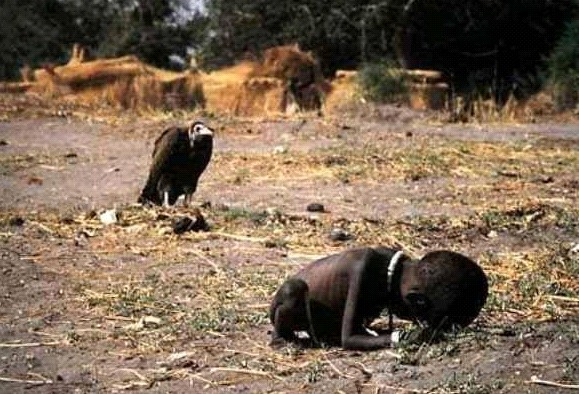 Vulrure waits for African child to die